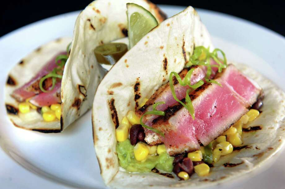 The Brook Tavern,139 Union Ave,Saratoga Springs, NY,518-871-1473.Visit Web site.Read our review.Ahi Tuna Tacos with Southwest spice, black bean and sweet corn salsa, fresh cilantro and avocado served with jalapeno lime sour cream on Friday, July 19, 2013, at The Brook Tavern in Saratoga Springs, N.Y. (Cindy Schultz / Times Union) Photo: Cindy Schultz / 00023232A