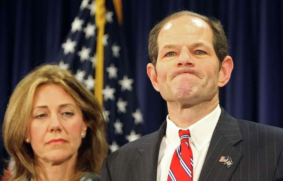 Silda Wall Spitzerstood by New York Gov. Eliot Spitzer after he was linked to a prostitution ring in 2008. He was eventually forced to step down. But in 2013, she wasn't by his side during his unsuccessful bid for New York City comptroller. On Christmas Eve, it was announced the couple split up.  Photo: Mario Tama, Getty Images / 2008 Getty Images