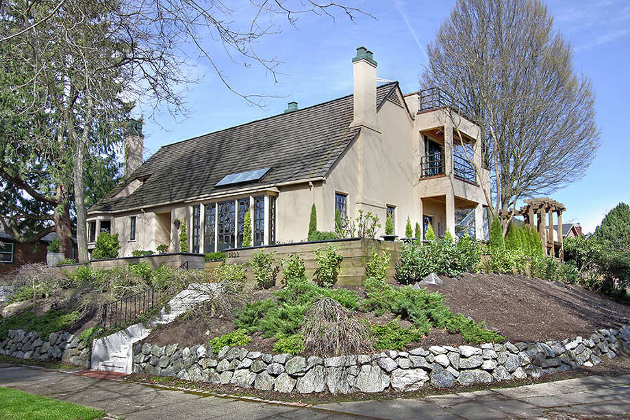 For less than $1 million, you could buy this big, distinctive home in Mount Baker, 3822 S. Court St. The 3,550-square-foot house, built in 1925, has four bedrooms, two bathrooms, a family room, vaulted ceilings, walls of windows, arched doorways, skylights, two fireplaces, a study/den, a media room, a wine cellar, a balcony, a roof deck, a patio, and views of Lake Washington, the Cascade Mountains and downtown Seattle on a 5,400-square-foot lot. It's listed for $960,000. Photo: Jenni Jenkins With Vicaso,  Courtesy Adam Morrow,  Sound Counsel Realty