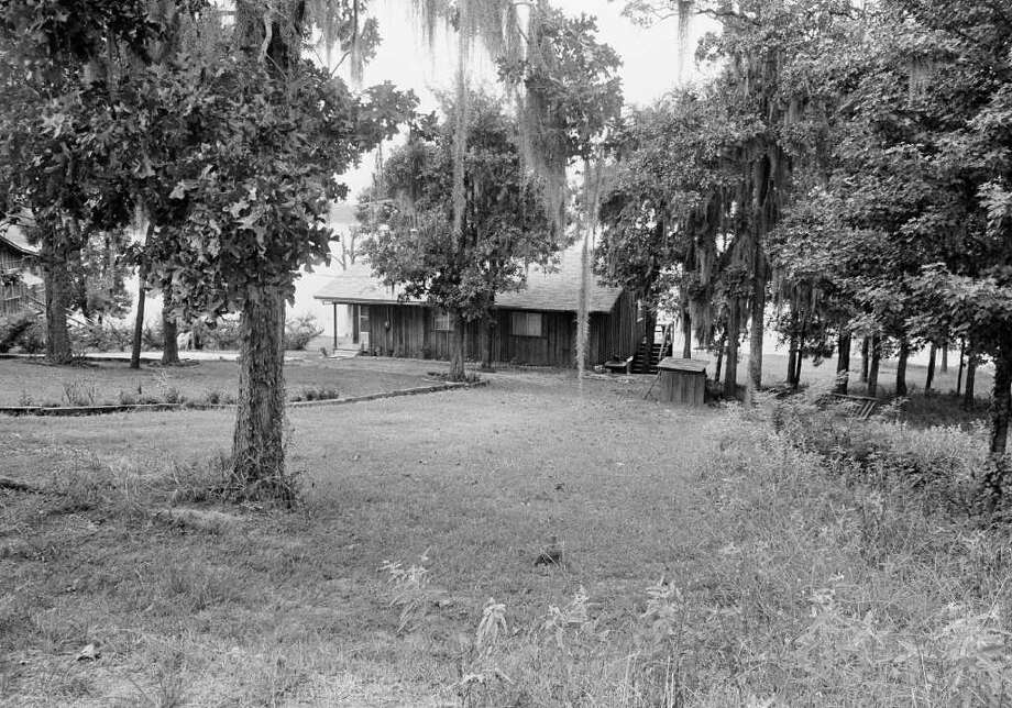 This cabinnear Lake Sam Rayburn in Broaddus, Texas, is owned by the family of Dean Corll, 33, the alleged central figure in 1973 a mass slaying case. Sheriff's deputies searched the cabin and found torture items inside the cabin and under it. (AP Photo) Photo: Anonymous, ASSOCIATED PRESS / AP1973