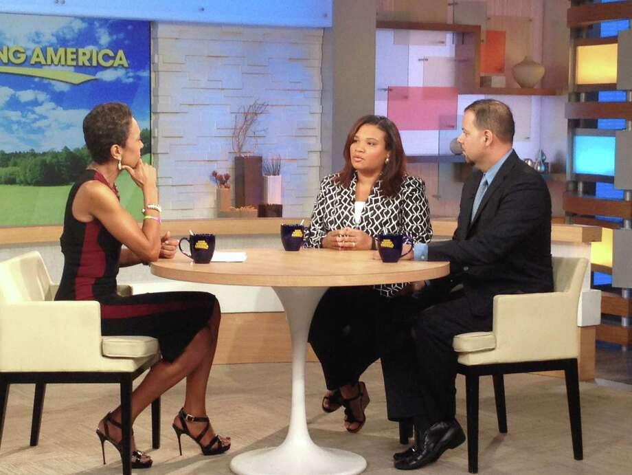 """This image released by ABC shows host Robin Roberts, left, with Juror B29 from the George Zimmerman trial, center, and attorney David Chico on """"Good Morning America,"""" in New York on Thursday, July 25, 2013.  Portions of Roberts' interview with the only minority juror from the Zimmerman trial, will air on """"World News Tonight with Diane Sawyer,""""  and """"Nightline"""" on Thursday and the full interview will air on """"Good Morning America,"""" on Friday. Photo: ABC, Donna Svennevik"""