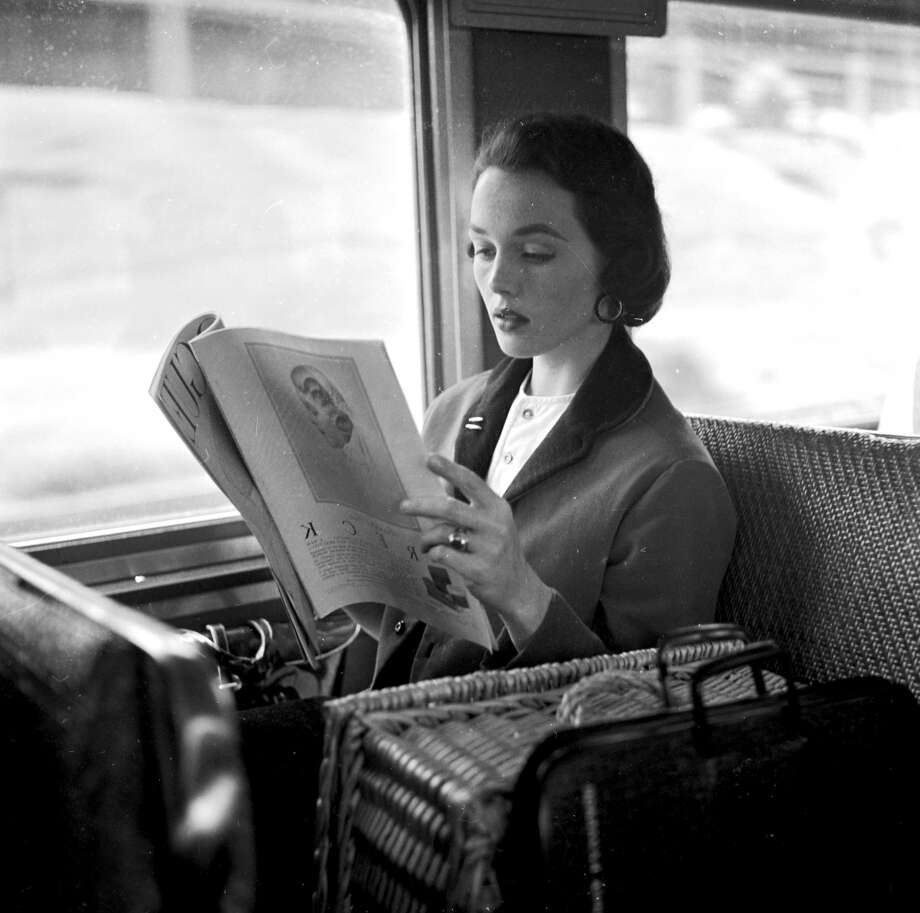 Successful New York fashion model, Ginny Cavanaugh reads a magazine while commuting to the city in 1950. Photo: Al Barry, Getty Images