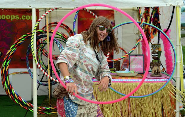 Courtney Roy, of Milford, plays with a hoop, during the 18th Annual Gathering of the Vibes music festival at Seaside Park in Bridgeport, Conn. on Thursday July 25, 2013. Roy is helping owner of We Sell Hoops to sell and demo them. Photo: Christian Abraham / Connecticut Post freelance