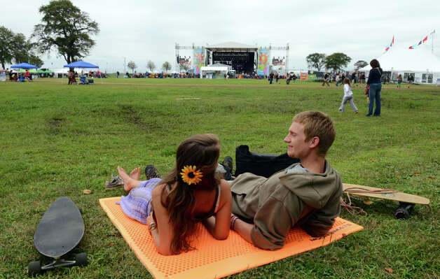 Brendan Daniel and his girlfriend Ariana Adreien, from Shirley, MA, practically have the lawn to themselves as they listen to the band Wild Adriatic, during the 18th Annual Gathering of the Vibes music festival at Seaside Park in Bridgeport, Conn. on Thursday July 25, 2013. Photo: Christian Abraham / Connecticut Post freelance