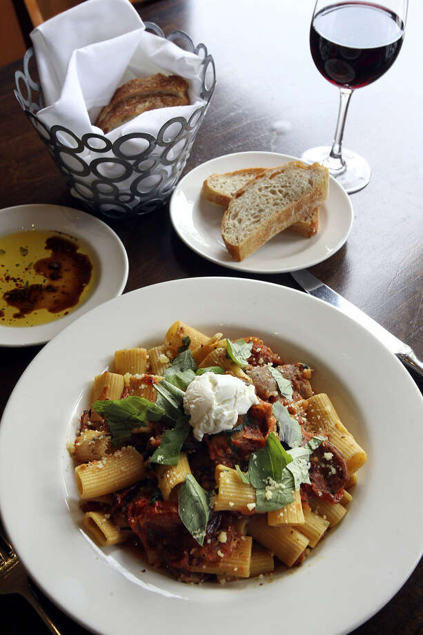 Sausage, slivers of garlic and roasted tomatoes, basil, Parmesan and creamy goat cheese help make the rigatoni at Piatti exceptional. Photo: Tom Reel / San Antonio Express-News