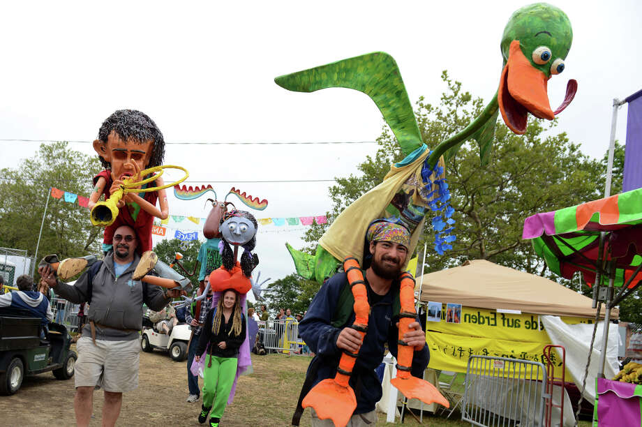 "Members of Ash Street Puppet Works in Manchester, NH, meander through the grounds with their creations, during the 18th Annual Gathering of the Vibes music festival at Seaside Park in Bridgeport, Conn. on Thursday July 25, 2013. At right is Jared Davis with Dell the Duck, at left is Jeff ""Ducky"" Vigneault with his puppet Woo Hoo, and in back is Amanda Arbour with Bertha.Bringing up the rear is Mike Vigneault with Marty the Moose. Photo: Christian Abraham / Connecticut Post freelance"