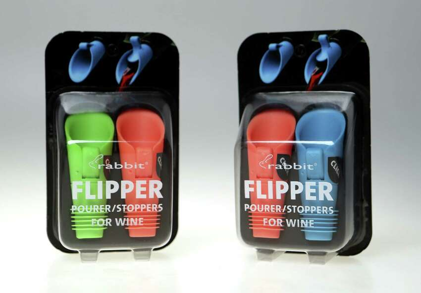 Flip to open and close these airtight wine stoppers that are reusable and dishwasher safe. The pourer is also drip-free, so no spills. Available in sets of two for $8 at www.metrokane.com