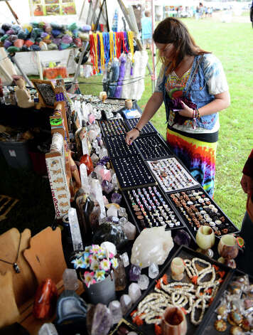 Courtney Adriaansen, of Amherst, NH, shops at Wormtown in the vendors area, during the 18th Annual Gathering of the Vibes music festival at Seaside Park in Bridgeport, Conn. on Thursday July 25, 2013. Photo: Christian Abraham / Connecticut Post freelance