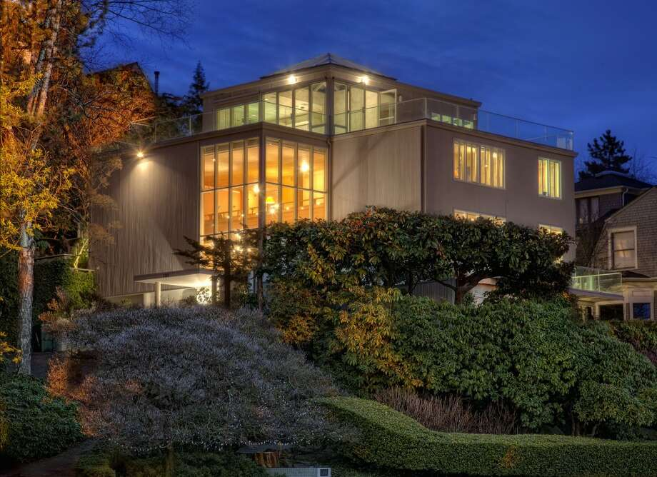 "Roland Terry was born in Seattle in 1917, earned his bachelor's degree in architecture from the University of Washington in 1940 and worked in the city throughout his career, aside from a four-year stint in the military during World War II.In Seattle, he became a leader in the Northwest take on modern architecture, according to docomomo WEWA (Documentation and Conservation of the Modern Movement, Western Wa.). Notable projects include Canlis Restaurant (1951), Washington Park Towers (1967), the Seatac Hilton Inn Restaurant (1960), the Doubletree Inn (1970), the old Nordstrom's downtown store (1970) and many houses, including this one for sale in Washington Park, 1101 McGilvra Boulevard E. Terry died in 2006.The Washington Park house is 5,150 square feet, with four bedrooms, 4.25 bathrooms, two-story walls of windows, wood walls and ceilings, four fireplaces, a family room, a library, a bar, a ""cloud room"" with a hot tub and glass ceiling, 1,226 square feet of decks, and views of Lake Washington, the Cascade Mountains and Bellevue on a 7,800-square-foot lot. It's listed for $2.85 million. Photo: Matt Edington,  Clarity Northwest,  Courtesy Chris Sudore,  King County Estates,  Coldwell Banker Bain"