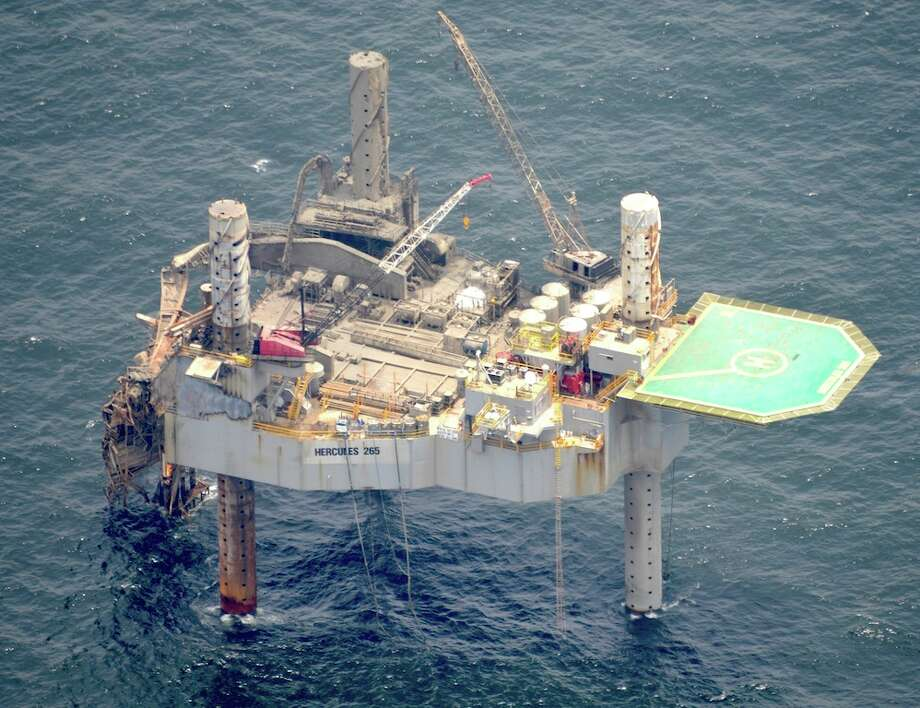The Hercules 265 jack-up rig in the Gulf of Mexico was severely damaged after a natural gas well leak ignited a fire, collapsing a portion of the structure, on Wednesday, July 24. Photo: On Wings Of Care, Copyright 2013