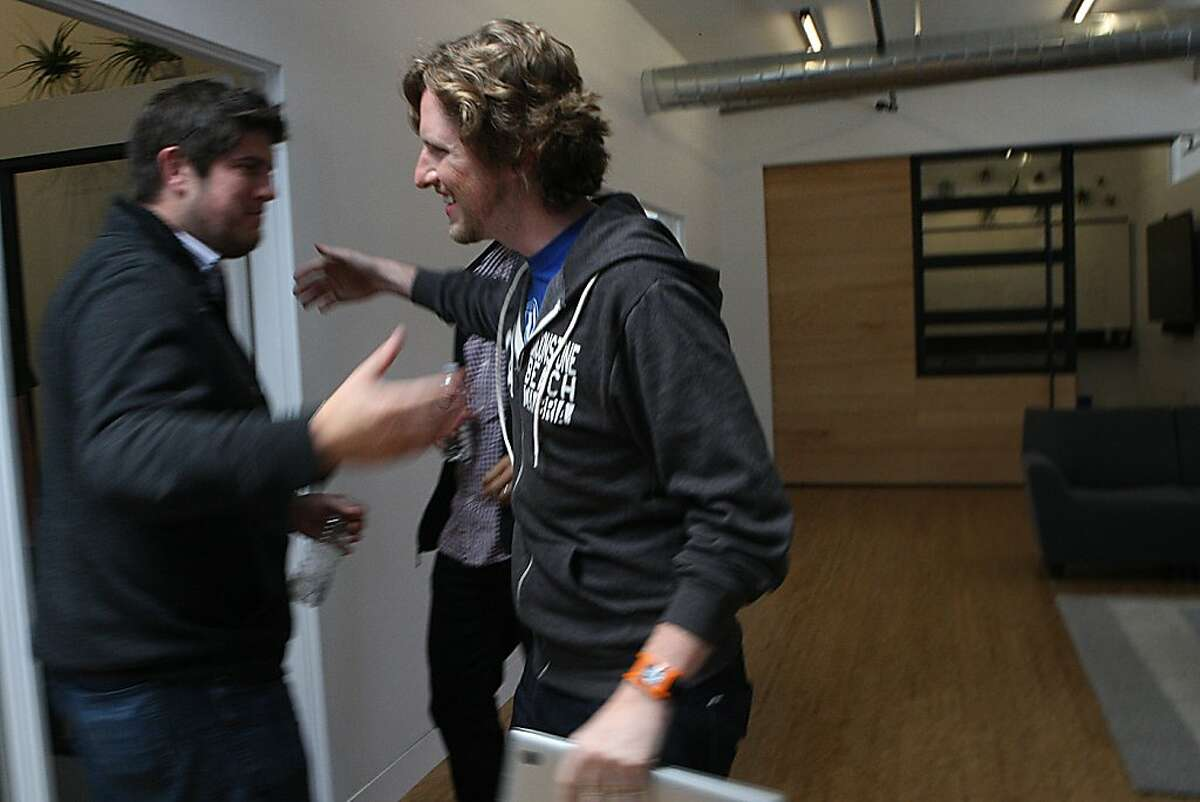 Wordpress founder Matt Mullenweg (right) greets entrepreneur Ryan Sarver (left) in his new office building in San Francisco, Calif., on Wednesday, July 24, 2013, where this coming weekend will be its annual WordCamp conference.