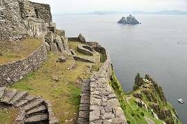 Some of the monastical structures atop Skellig Michael Island with Little Skellig Island in the distance.