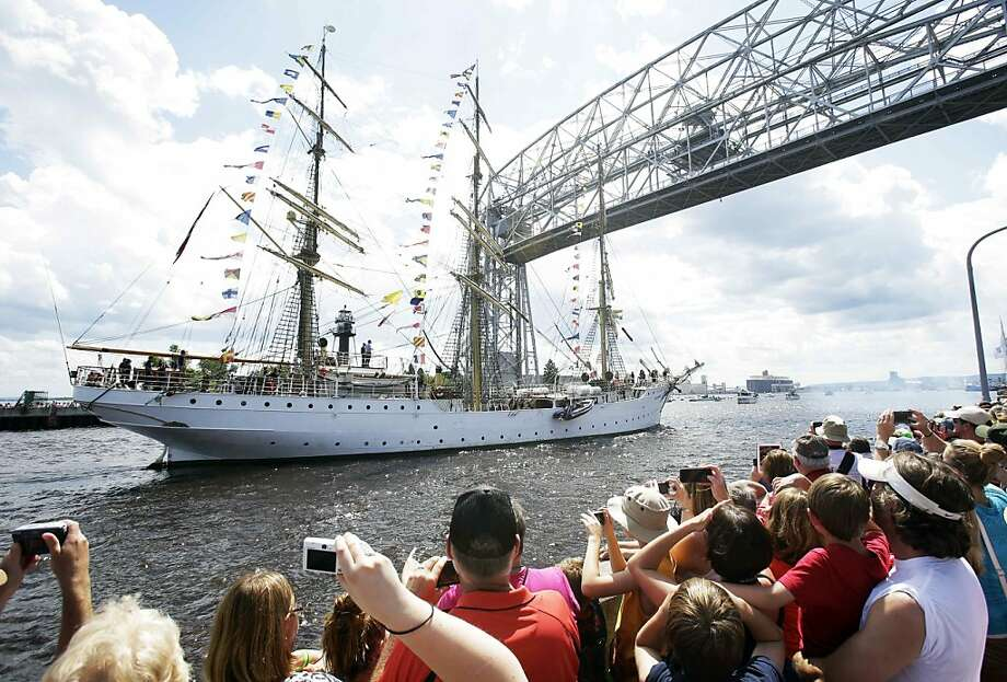 Thousands of people gathered as the SS Sorlandet of Norway enters  the ship canal from Lake Superior into the Duluth harbor during the parade of tall ships festival Thursday, July 25, 2013. in Duluth, Minn. (AP Photo/Jim Mone) Photo: Jim Mone, Associated Press