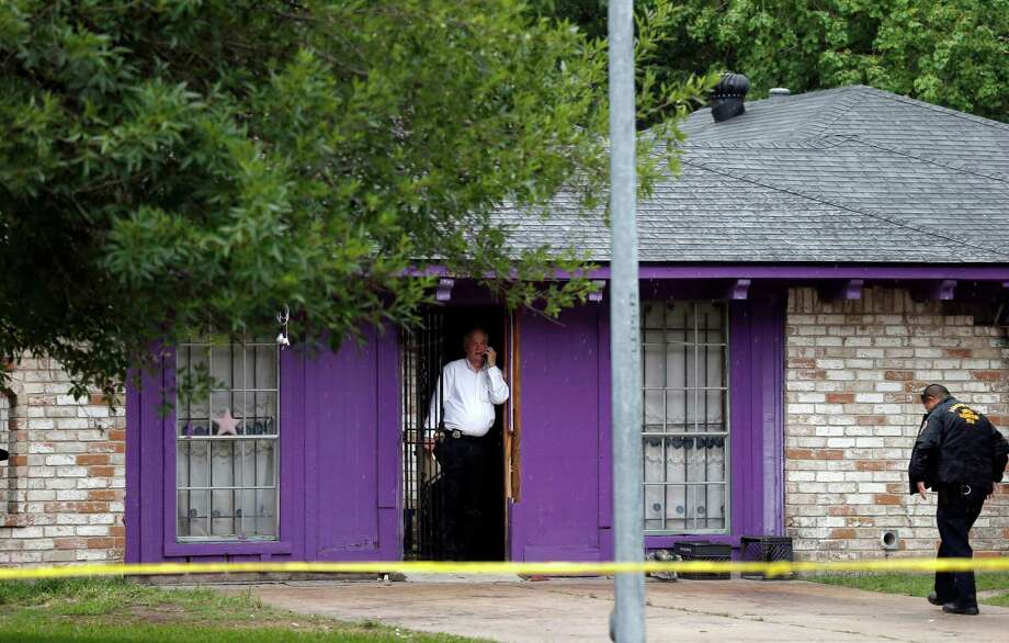 File - In this July 19, 2013 file photo, authorities investigate a home in Houston, where police say four homeless men were found in deplorable conditions. The nonprofit operating out of the home had apparently been started with the best of intentions: to feed and shelter homeless individuals. But Regina's Faith Ministries soon ran afoul of its philanthropic goals as it lost its nonprofit status, violated state licensing regulations and, according to authorities, ended up turning its shelter into a dungeon-like prison where three of the four men say they were held against their wills so their captor could cash their public assistance checks. Photo: Pat Sullivan