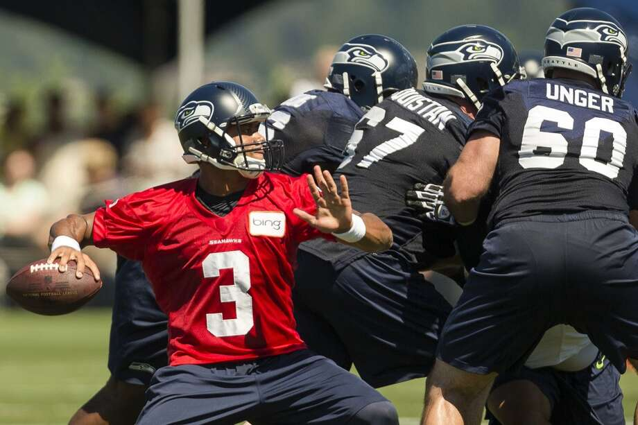 Quarterback Russell Wilson (3) prepares to throw to at teammate during a drill at the opening day of the Seattle Seahawks training camp Thursday, July 25, 2013, at the Virginia Mason Athletic Center in Renton. The sold-out training camp runs through the preseason in August. Nearly 25,000 fans are expected to attend this month. (Jordan Stead, seattlepi.com) Photo: JORDAN STEAD, SEATTLEPI.COM