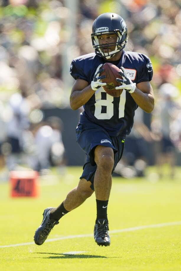 Golden Tate makes a catch at the opening day of the Seattle Seahawks training camp Thursday, July 25, 2013, at the Virginia Mason Athletic Center in Renton. The sold-out training camp runs through the preseason in August. Nearly 25,000 fans are expected to attend this month. (Jordan Stead, seattlepi.com) Photo: SEATTLEPI.COM