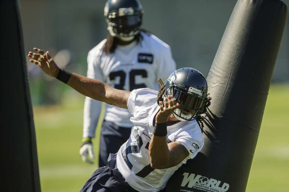 Winston Guy, foreground, runs an offensive play with teammates during the opening day of the Seattle Seahawks training camp Thursday, July 25, 2013, at the Virginia Mason Athletic Center in Renton. The sold-out training camp runs through the preseason in August. Nearly 25,000 fans are expected to attend this month. (Jordan Stead, seattlepi.com) Photo: SEATTLEPI.COM