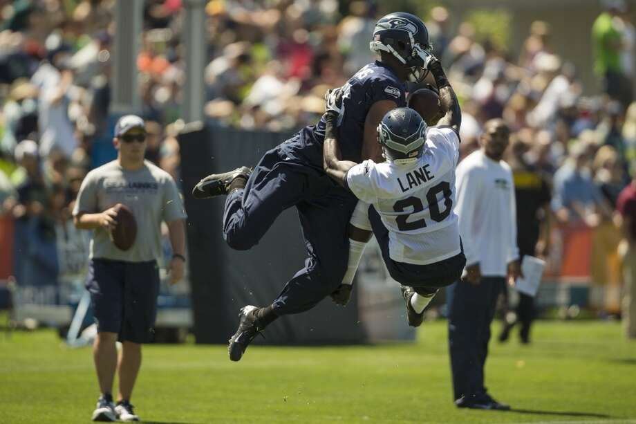 Offensive and defensive players collide in mid-air during a drill at the opening day of the Seattle Seahawks training camp Thursday, July 25, 2013, at the Virginia Mason Athletic Center in Renton. The sold-out training camp runs through the preseason in August. Nearly 25,000 fans are expected to attend this month. (Jordan Stead, seattlepi.com) Photo: SEATTLEPI.COM
