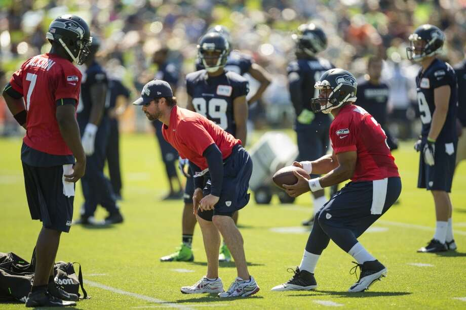 Quarterback Russell Wilson prepares to throw to at teammate during a drill at the opening day of the Seattle Seahawks training camp Thursday, July 25, 2013, at the Virginia Mason Athletic Center in Renton. The sold-out training camp runs through the preseason in August. Nearly 25,000 fans are expected to attend this month. (Jordan Stead, seattlepi.com) Photo: SEATTLEPI.COM