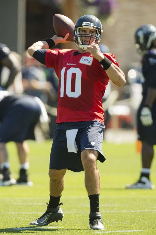 Quarterback Brady Quinn prepares to throw to at teammate during a drill at the opening day of the Seattle Seahawks training camp Thursday, July 25, 2013, at the Virginia Mason Athletic Center in Renton. The sold-out training camp runs through the preseason in August. Nearly 25,000 fans are expected to attend this month. (Jordan Stead, seattlepi.com) Photo: SEATTLEPI.COM