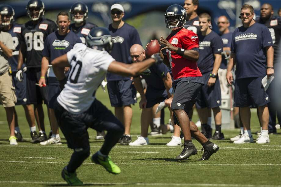 Quarterback Tarvaris Jackson, center, prepares to throw to at teammate during a drill at the opening day of the Seattle Seahawks training camp Thursday, July 25, 2013, at the Virginia Mason Athletic Center in Renton. The sold-out training camp runs through the preseason in August. Nearly 25,000 fans are expected to attend this month. (Jordan Stead, seattlepi.com) Photo: SEATTLEPI.COM