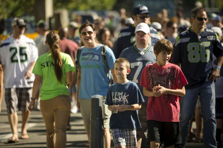 Fans flock to the opening day of the Seattle Seahawks training camp Thursday, July 25, 2013, at the Virginia Mason Athletic Center in Renton. The sold-out training camp runs through the preseason in August. Nearly 25,000 fans are expected to attend this month. (Jordan Stead, seattlepi.com) Photo: SEATTLEPI.COM