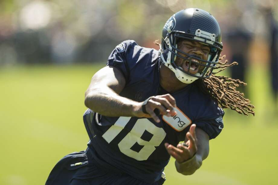 Sidney Rice lets out a yell after missing a catch at the opening day of the Seattle Seahawks training camp Thursday, July 25, 2013, at the Virginia Mason Athletic Center in Renton. The sold-out training camp runs through the preseason in August. Nearly 25,000 fans are expected to attend this month. (Jordan Stead, seattlepi.com) Photo: SEATTLEPI.COM