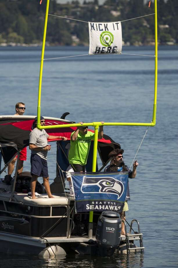 Fans watch the opening day of the Seattle Seahawks training camp from a boat Thursday, July 25, 2013, at the Virginia Mason Athletic Center in Renton. The sold-out training camp runs through the preseason in August. Nearly 25,000 fans are expected to attend this month. (Jordan Stead, seattlepi.com) Photo: SEATTLEPI.COM