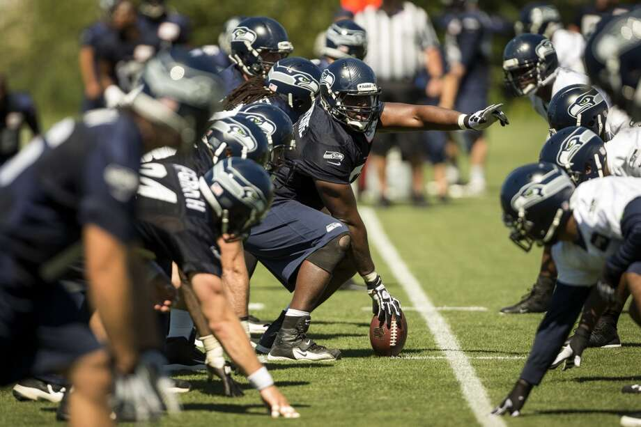 Players run drills at the opening day of the Seattle Seahawks training camp Thursday, July 25, 2013, at the Virginia Mason Athletic Center in Renton. The sold-out training camp runs through the preseason in August. Nearly 25,000 fans are expected to attend this month. (Jordan Stead, seattlepi.com) Photo: SEATTLEPI.COM