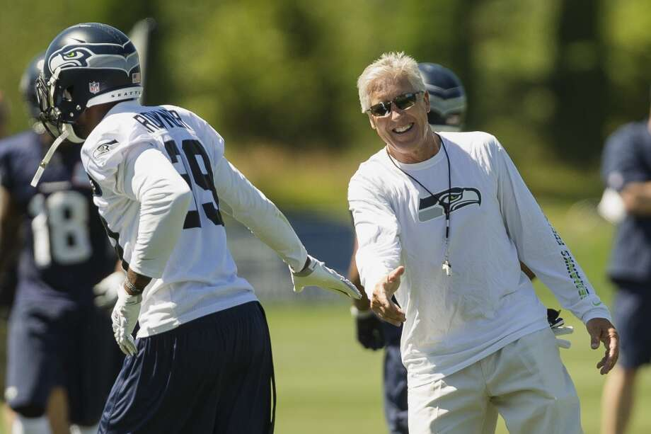 Head coach Pete Carroll, right, gives Brandon Browner, left, a high five after completing a drill at the opening day of the Seattle Seahawks training camp Thursday, July 25, 2013, at the Virginia Mason Athletic Center in Renton. The sold-out training camp runs through the preseason in August. Nearly 25,000 fans are expected to attend this month. (Jordan Stead, seattlepi.com) Photo: SEATTLEPI.COM
