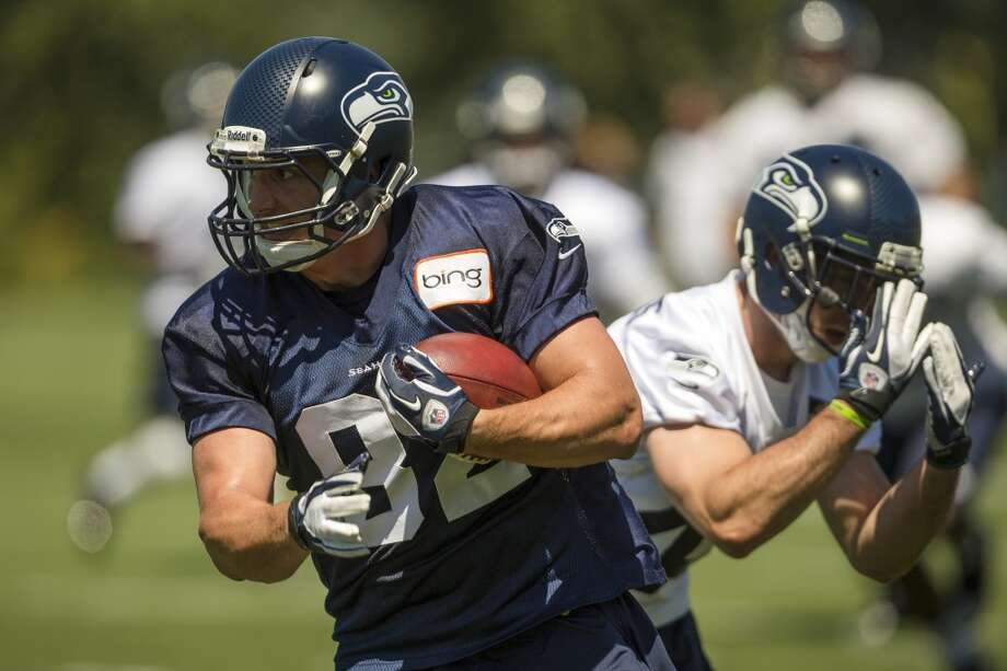 Luke Willson, left, runs a play at the opening day of the Seattle Seahawks training camp Thursday, July 25, 2013, at the Virginia Mason Athletic Center in Renton. The sold-out training camp runs through the preseason in August. Nearly 25,000 fans are expected to attend this month. (Jordan Stead, seattlepi.com) Photo: SEATTLEPI.COM