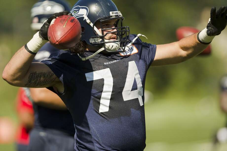 John Moffitt prepares to toss to a teammate at the opening day of the Seattle Seahawks training camp Thursday, July 25, 2013, at the Virginia Mason Athletic Center in Renton. The sold-out training camp runs through the preseason in August. Nearly 25,000 fans are expected to attend this month. (Jordan Stead, seattlepi.com) Photo: SEATTLEPI.COM