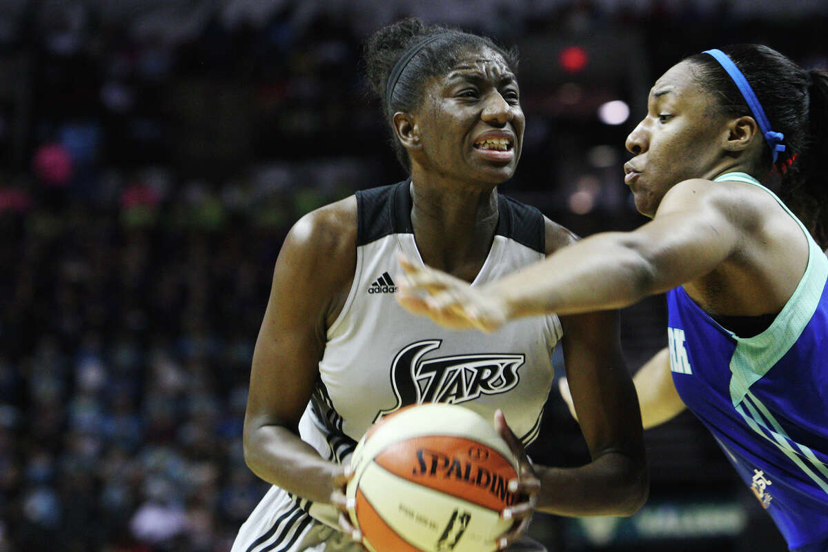 Silver Star's Shameka Christon dribbles past Liberty's Leilani Mitchell at the Silver Stars game against the New York Liberty at the AT&T center on Thursday, July 25, 2013. The Silver Stars won 65 to 53. The win was number 200 for head coach Dan Hughes.