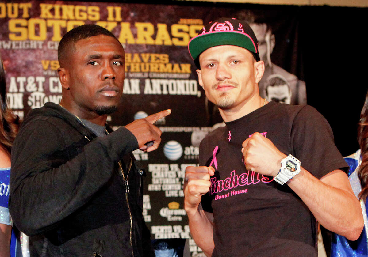 Two-Time Welterweight World Champion Andre Berto (left) and Mexican contender Jesus Soto Karass stand together on the stage during the final press conference for Knockout Kings II at the San Antonio Marriott Rivercenter on Thursday, July 25, 2013. The main event, to be held at the AT&T Center on July 27, features a fight between the two for the vancant NABF Welterweight title. MARVIN PFEIFFER/ mpfeiffer@express-news.net