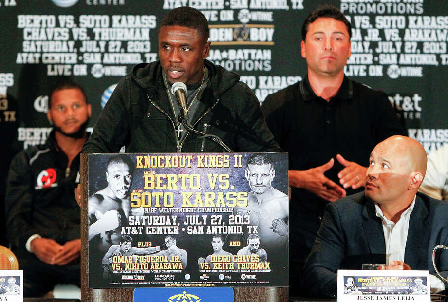 Two-Time Welterweight World Champion Andre Berto speaks with Jesse James Leija (from right) and Oscar De La Hoya on the stage with him during the final press conference for Knockout Kings II at the San Antonio Marriott Rivercenter on Thursday, July 25, 2013.  The main event, to be held at the AT&T Center on July 27, features  Berto (28-2) vs. Mexican contender Jesus Soto Karass (27-8-3) for the vancant NABF Welterweight title.  MARVIN PFEIFFER/ mpfeiffer@express-news.net Photo: MARVIN PFEIFFER, Marvin Pfeiffer/ Express-News / Express-News 2013