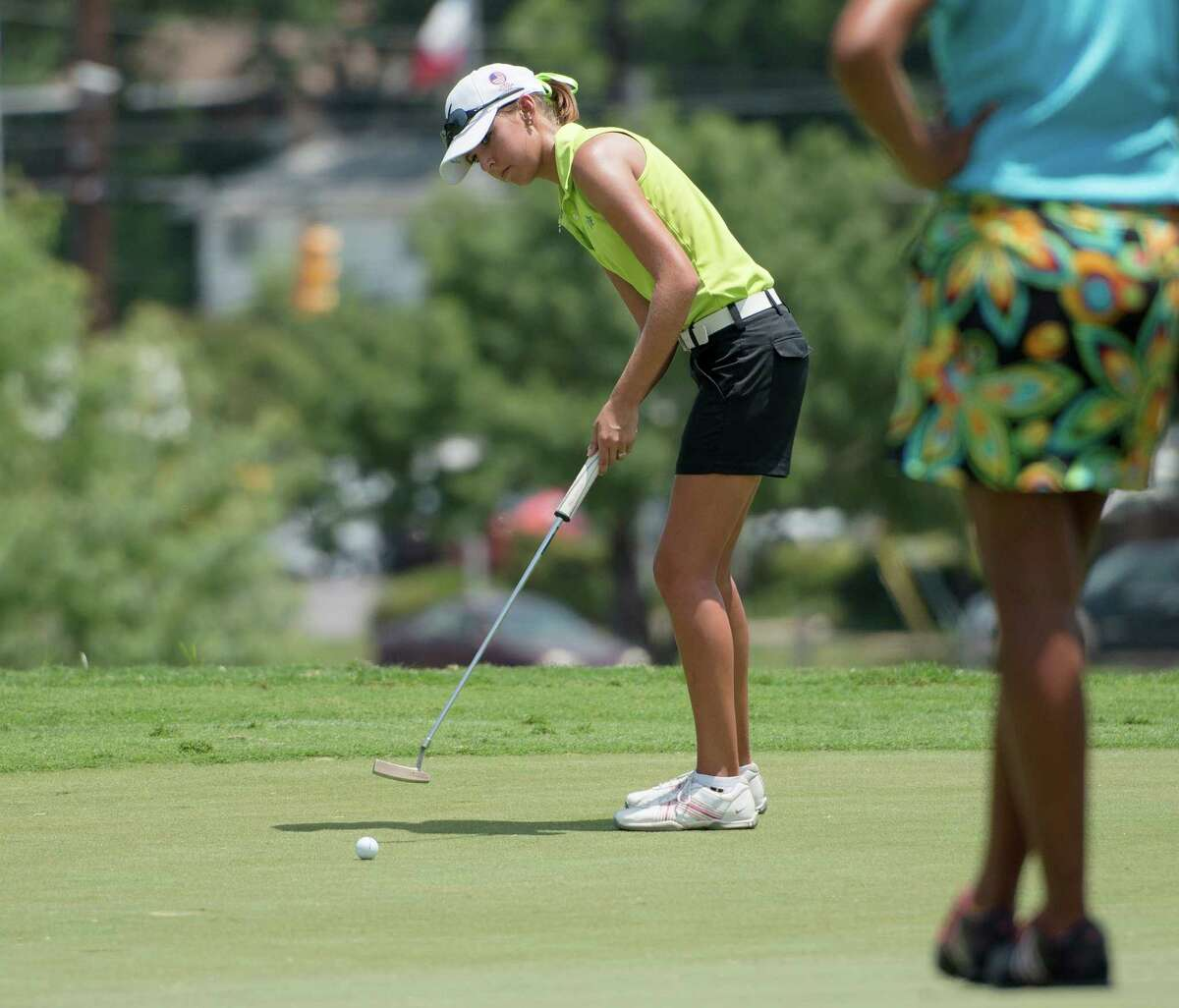 Caitlin Brown putts during the GSA Junior Championship, Thursday, July 25, 2013, at Brackenridge Park Municipal Golf Course in San Antonio. (Darren Abate/For the Express-News)
