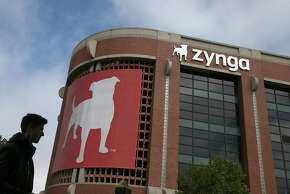 A pedestrian walks by the Zynga headquarters in San Francisco, California.