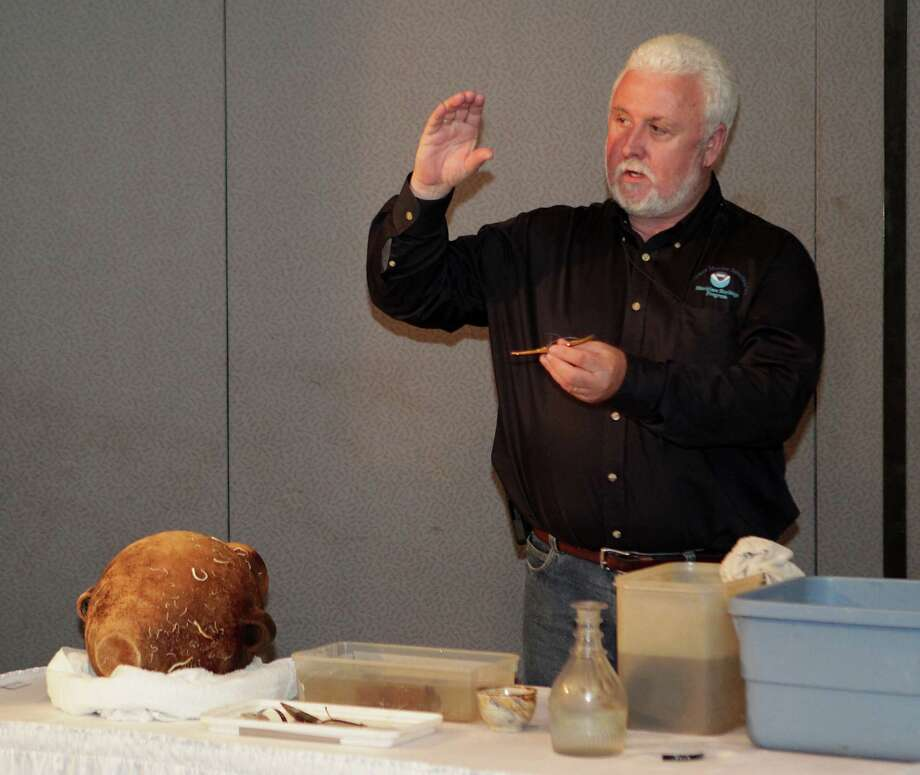 NOAA's (National Oceanic and Atmospheric Administration) Dr. James Delgado discusses the artifacts excavated from the Monterrey Shipwreck which returned the artifacts to Galveston today from a shipwreck about 170 miles off Galveston, during a press conference at Moody Gardens Thursday, July 25, 2013, in Galveston. Photo: James Nielsen, Houston Chronicle / © 2013  Houston Chronicle