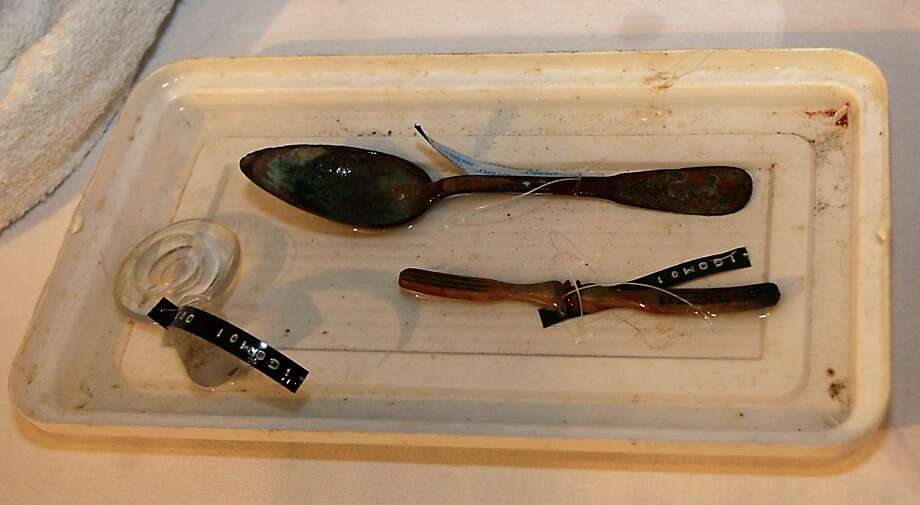 A spoon, toothbrush or comb and a bottle stopper which were some of the artifacts excavated from the Monterrey Shipwreck which returned the artifacts to Galveston today from a shipwreck about 170 miles off Galveston, during a press conference at Moody Gardens Thursday, July 25, 2013, in Galveston. Photo: James Nielsen, Houston Chronicle / © 2013  Houston Chronicle