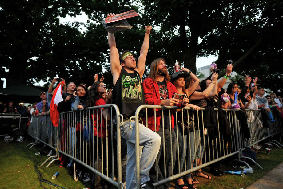 Mikey Basso, arms raised, and his brother, Mark, cheer on Bret Michaels during Alive@Five at Columbus Park in Stamford on Thursday, July 25, 2013. Hearst Connecticut Newspapers are a sponsor of the event. Photo: Jason Rearick / Stamford Advocate