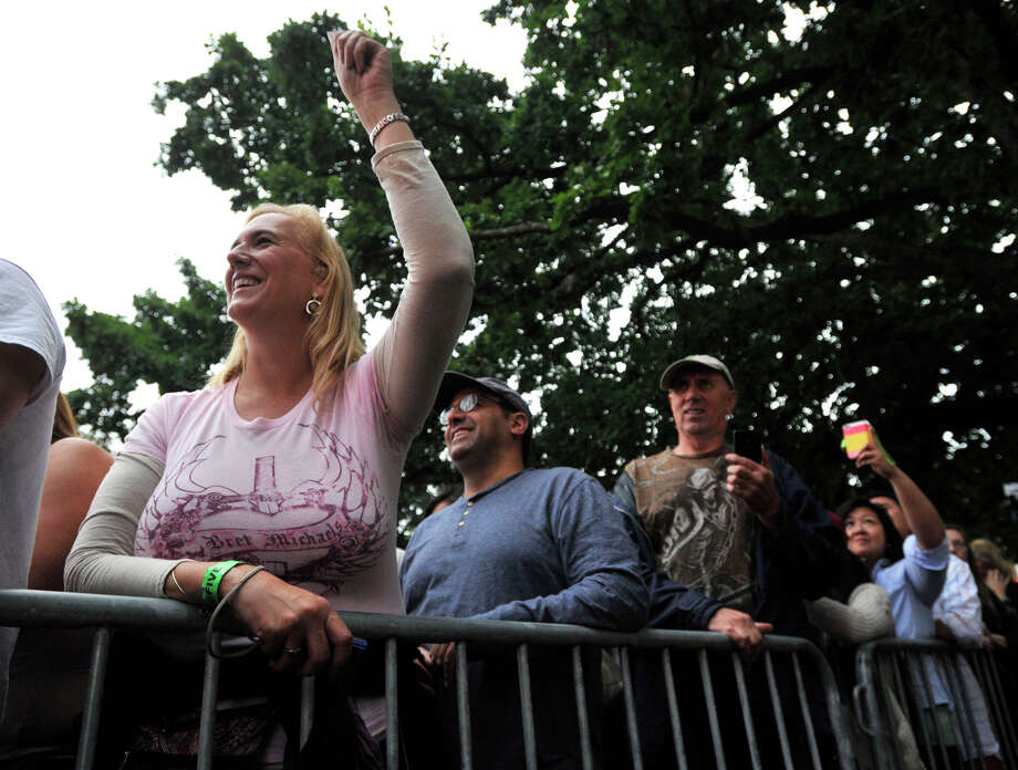 Michelle Lavrado, left, and her boyfriend, Paul Molnar, behind her, cheer on Bret Michaels during Alive@Five at Columbus Park in Stamford on Thursday, July 25, 2013. Hearst Connecticut Newspapers are a sponsor of the event. Photo: Jason Rearick / Stamford Advocate