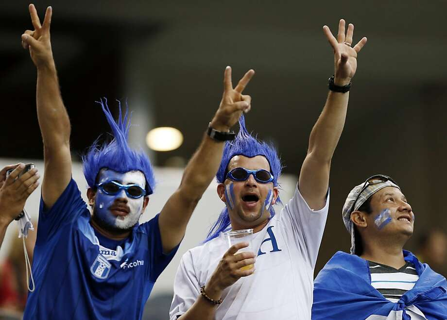 Honduras fans show their support before the start of the first half of the Gold Cup semifinals against the United States at Cowboys Stadium, Wednesday, July 24, 2013, in Arlington, Texas. The United States won 3-1. (AP Photo/Brandon Wade) Photo: Brandon Wade, Associated Press