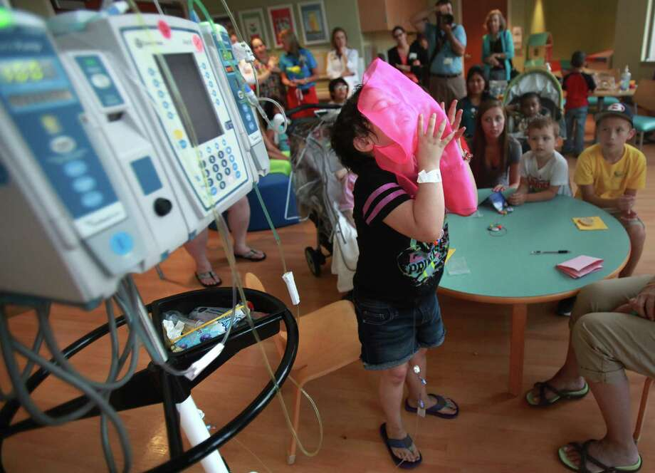 """""""I love clowns"""" says Kaitlynn Jones, 6, as she learns how to juggle with fabric during a visit from members of the Ringling Bros. and Barnum & Bailey's World Famous Clown Alley at M.D. Anderson on Thursday, July 25, 2013, in Houston. Photo: Mayra Beltran, Houston Chronicle / © 2013 Houston Chronicle"""