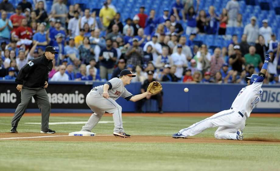 Edwin Encarnacion is out at third base as Matt Dominguez takes the throw in the fourth inning. Jose Bautista scored on the play. Photo: Brad White, Getty Images