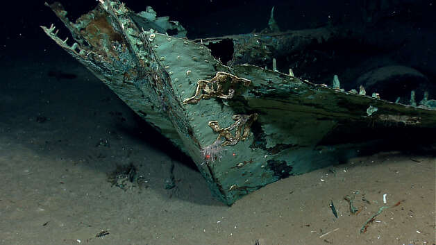 Oxidized copper hull sheathing and possible draft marks are visible on the bow of a wrecked ship in the Gulf of Mexico about 160 miles from Galveston. Officials say the two-masted ship, the subject of a recovery expedition, may be 200-years-old. Photo: NOAA Okeanos Explorer Program / Associated Press