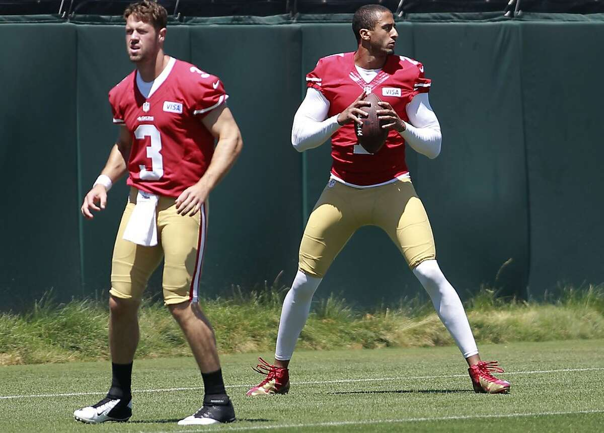 49ers' quarterback's Scott Tolzien, (3) and Colin Kaepernick, (7) take turns at snaps during an afternoon practice at the San Francisco 49ers training camp in Santa Clara, Calif. on Thursday July 25, 2013.