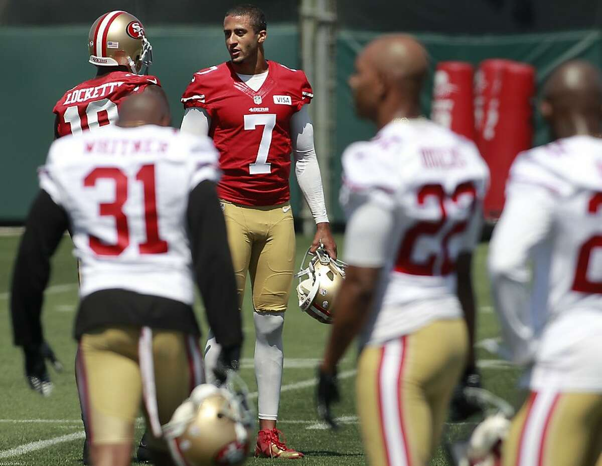 49ers quarterback Colin Kaepernick, (7) talks with wide receiver Ricardo Lockett,(18) during an afternoon session of practice at the San Francisco 49ers training camp in Santa Clara, Calif. on Thursday July 25, 2013.