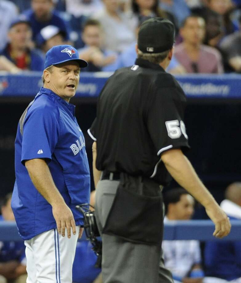 Manager John Gibbons of the Blue Jays has words with home plate umpire Paul Emmel. Photo: Brad White, Getty Images