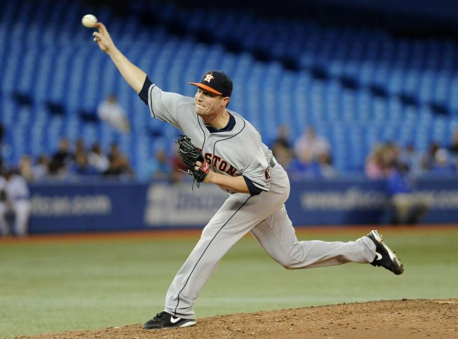 Lucas Harrell delivers a pitch. Photo: Brad White, Getty Images