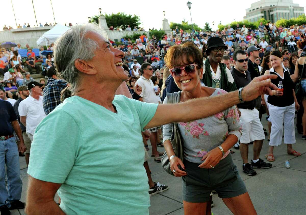 Friends Mike Stewart of Rensselaer, left, and Colleen Mayo of Cohoes dance to the music of The Tom Healey Band during Alive at Five on Thursday, July 25, 2013, at Jennings Landing in Albany, N.Y. (Cindy Schultz / Times Union)